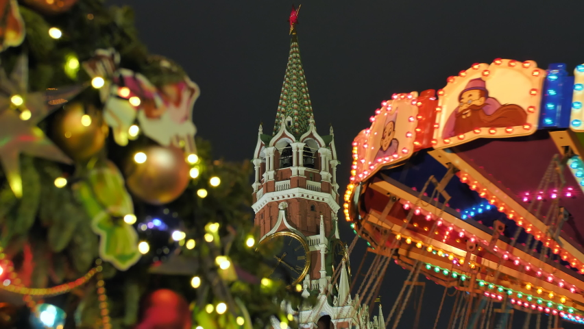 Russian carousel against the background of the Red Square against the background of the Kremlin. Royalty-Free Stock Footage #1063210939