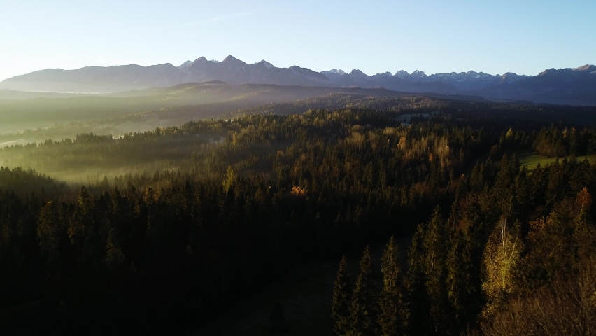 Mountain aerial, epic view. Aerial view of mountain landscape with morning fog, Tatra high mountains in the sunny morning after sunrise. Drone footage of misty forest and magical alpine scenery | Shutterstock HD Video #1063243138