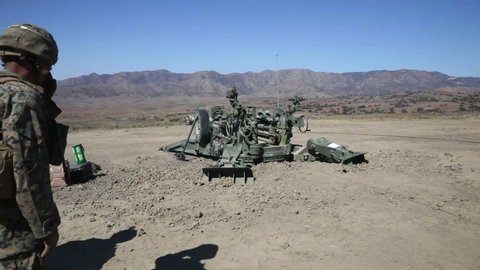 CIRCA 2020 U.S. Marines direct fire drill with M777 howitzer, Marine Corps Combat Readiness Evaluation, Camp Pendleton, CA.