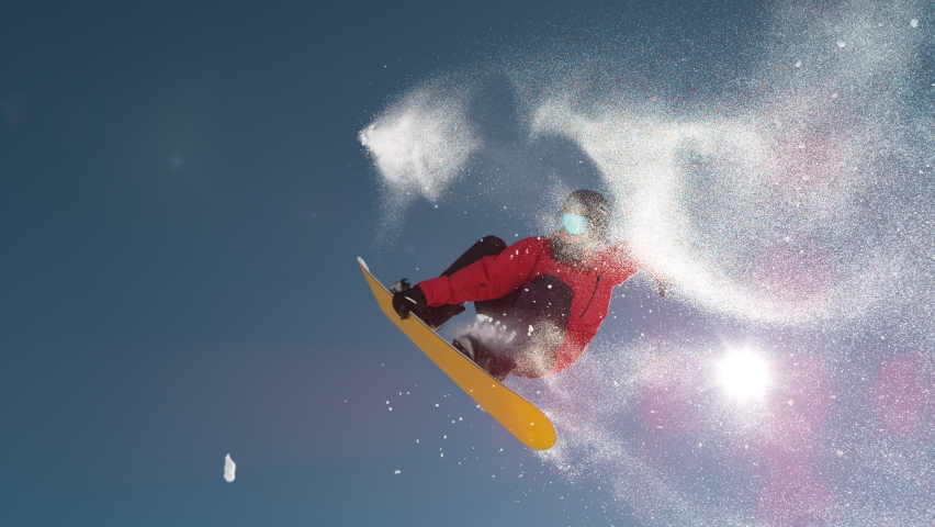 SLOW MOTION TIME WARP, LENS FLARE, BOTTOM UP: Fearless snowboarder does a spin trick while riding off a big air kicker. Snowflakes sparkle in the sunshine as male tourist does snowboarding tricks. Royalty-Free Stock Footage #1063265116