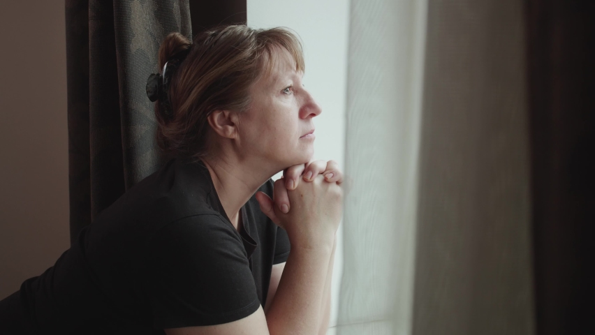 Upset depressed mature woman crying alone at home thinking of loneliness or grief, sad middle aged senior woman in tears worried about health problems mourning feeling lonely miserable concept Royalty-Free Stock Footage #1063284166