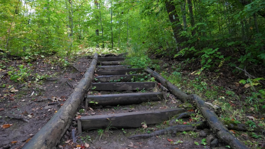 POV Climbing Wooden Stairs Along Outdoor Hiking Trail in Fall Season | Shutterstock HD Video #1063293007