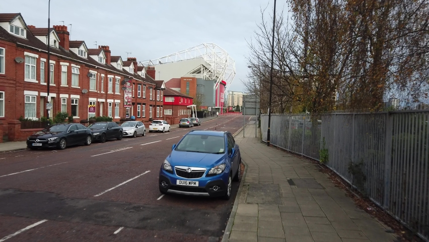MANCHESTER, UK - 2020: Old Trafford stadium and the streets of Manchester