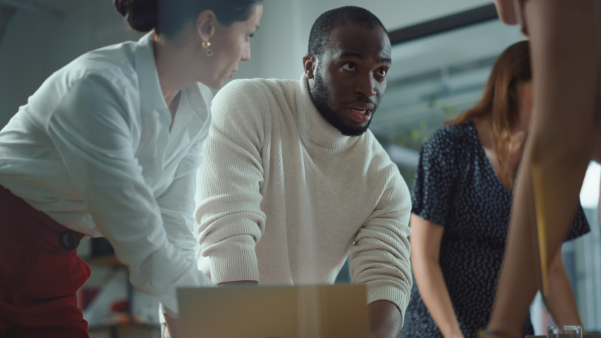 Diverse Team of Professional Businesspeople Meeting in the Office Conference Room. Creative Team Around Table, Black Male and Caucasian Female Speak for Marketing Compain, Social Media Strategy Royalty-Free Stock Footage #1063309474