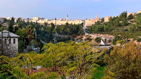 Franciscan Monastery of Saint Saviour, Jaffa Gate, Tower of David and the walls of Old City Jerusalem with beautiful trees; panoramic view over the Hinnom valley or Gehenna and Sultan's Pool