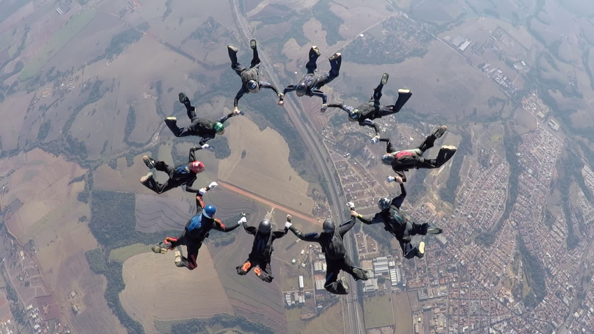 Skydiving people doing a formation in free fall | Shutterstock HD Video #1063313692