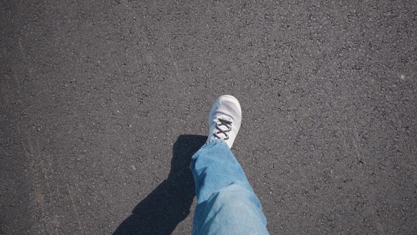 4K - Feet Walking On The Asphalt POV video | Shutterstock HD Video #1063313863