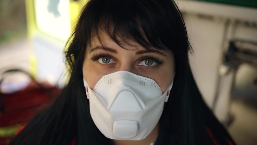 Close view on paramedic's eyes staring at you inside ambulance vehicle | Shutterstock HD Video #1063321756