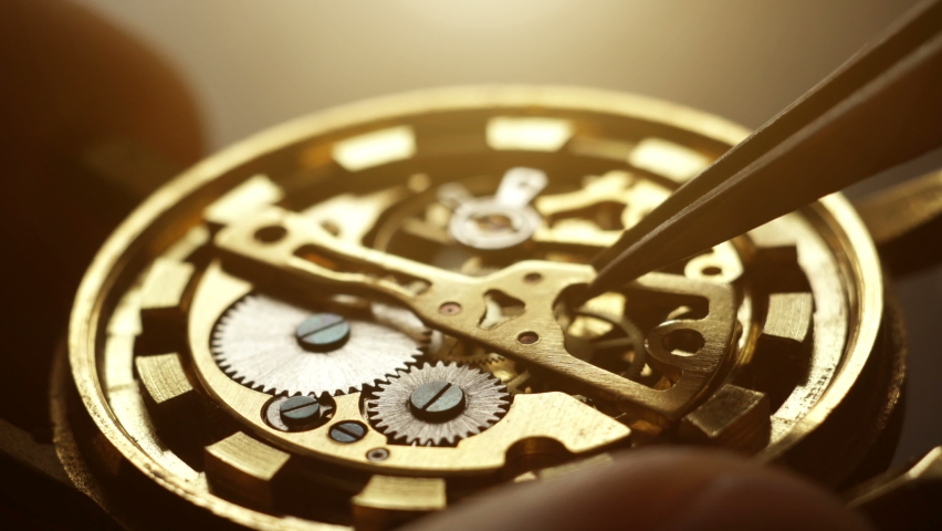 Mechanical watch repair with special tools, watchmaker's workshop   Shutterstock HD Video #1063329748