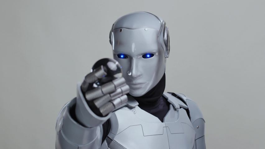 Silver robotic futuristic cyborg exploring a glass ball isolated on grey background. Future concept. Artificial intelligence. Realistic. Technologies. | Shutterstock HD Video #1063330096