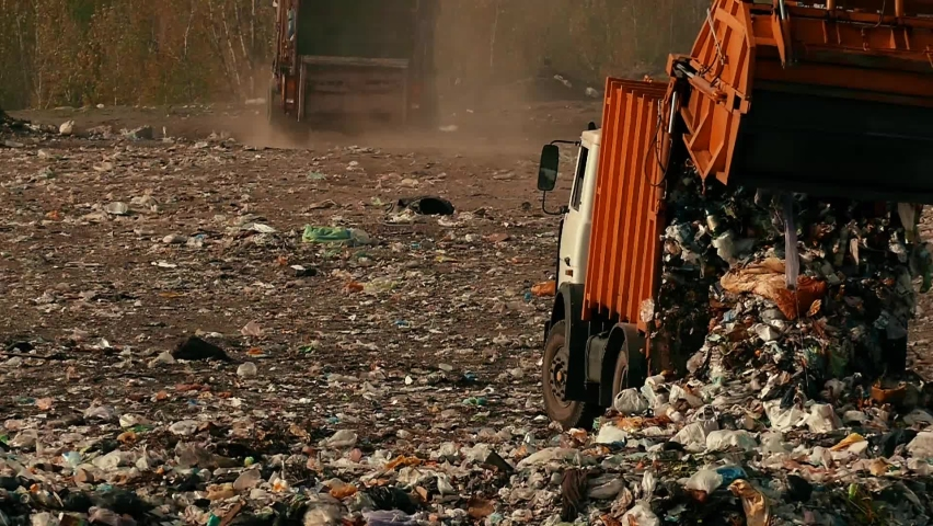 Trash is poured out of the garbage truck copy space. Damage to the environment. Pollution concept. Landfill in slow motion. | Shutterstock HD Video #1063331200