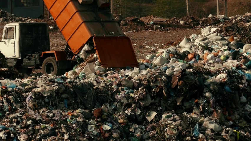 Garbage bags are poured out of the garbage truck. Damage to the environment. Pollution concept. Landfill in slow motion. | Shutterstock HD Video #1063331215
