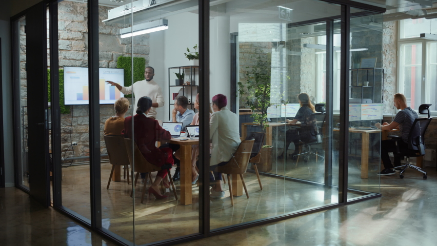 Office Conference Room Meeting: Male Chief Executive Talking to a Diverse Team of Professional Businesspeople. Creative People Listen to CEO Discuss Design, Data Analysis, Plan Marketing Strategy | Shutterstock HD Video #1063349527