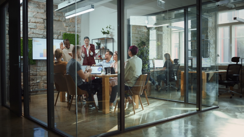Two Owners of Promising Start-up Company Tell Good News to Diverse Team of Investors, Workers, Colleagues. Group of Multi Ethnic Business Professionals Celebrate Successful Product Release Royalty-Free Stock Footage #1063359145