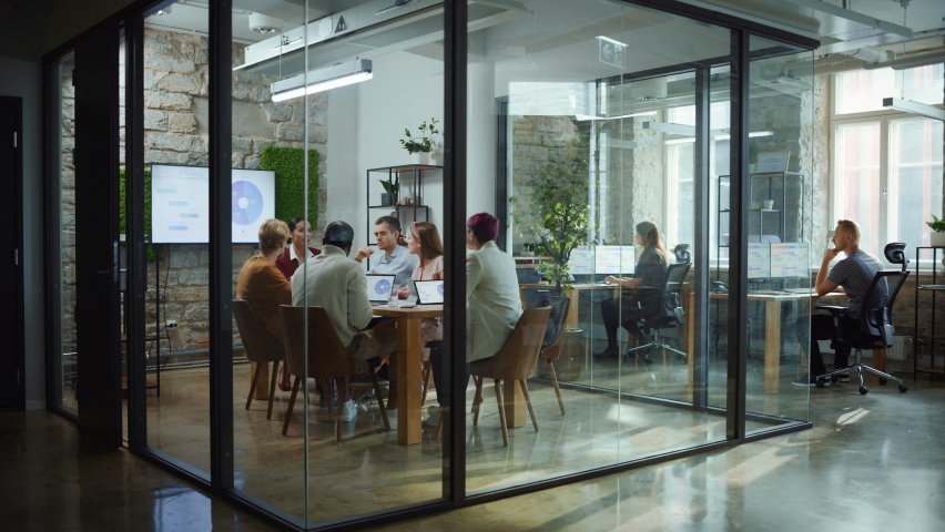 Diverse Group of Professional Businesspeople Meeting in the Modern Office Conference Room. Creative Team Discuss App Design, Analyze Data, Plan Marketing Strategy, Disrupt Social Media, Growth Hack | Shutterstock HD Video #1063359211