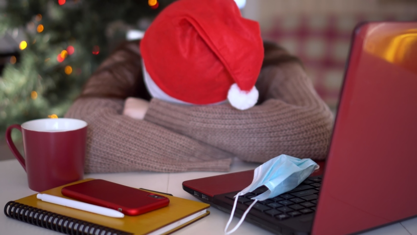 female studentin santa hat makes conference video call on laptop computer talks with web tutor, online teacher in remote webcam chat on screen. Distance education class concept. Royalty-Free Stock Footage #1063371634