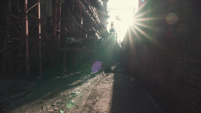 First-person view moving forward through old rusty abandoned industrial metallurgical plant in sunlight | Shutterstock HD Video #1063372708