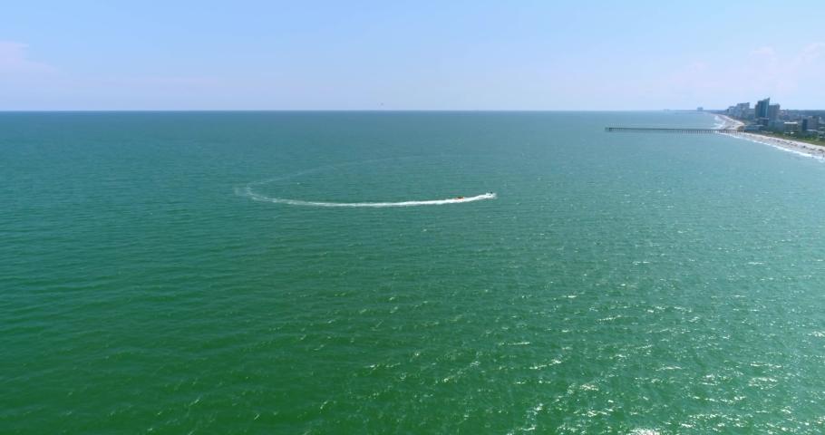 Aerial Drone, Boat in the Ocean Along Myrtle Beach