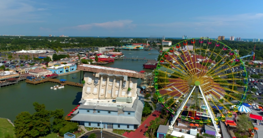 Myrtle Beach, South Carolina, United States - August 17, 2020: Myrtle Beach by Aerial Drone, Skywheel, Tourists, 4K
