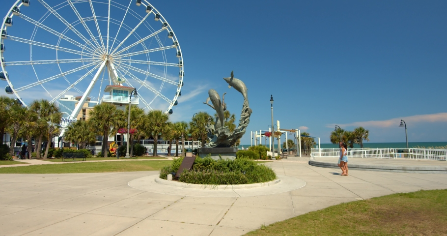Myrtle Beach, South Carolina, United States - August 17, 2020: Dolphin Statue, Sculpture at Myrtle Beach, South Carolina