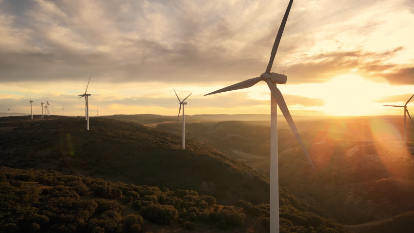 Scenic Aerial view of wind turbines farm in sunset time. High quality 4k footage Royalty-Free Stock Footage #1063382569