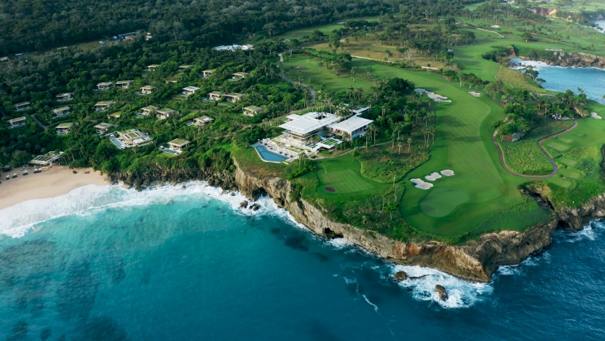Golf hotel on the rocky coast Caribbean sea. Golf course and villas on the beach. Dominican Republic beach background.   Shutterstock HD Video #1063397050