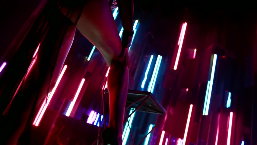 Sexy stripper lady is stroking her long slender leg, peep show in strip club, lap dancing