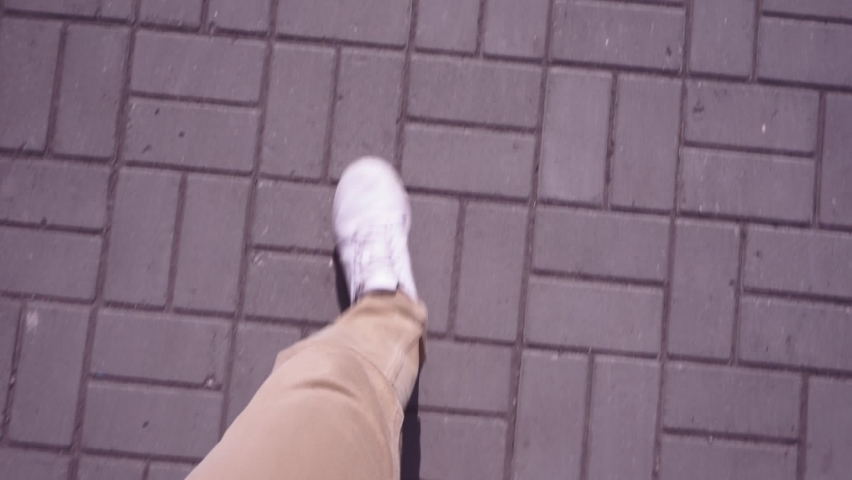 Man in white sneakers walks down the street on a bright sunny day. pov video, first person. | Shutterstock HD Video #1063400344