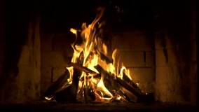 Burning Fire In The Fireplace. Slow Motion. A Looping Clip of a Fireplace with Medium Size Flames Winter and Christmas Holidays Concept