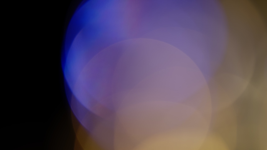 Multicolored light leaks 4k footage on black background. Lens studio flare leak burst overlays. Natural lighting lamp rays bokeh effect. For compositing over your footage, stylizing video, transitions | Shutterstock HD Video #1063418650