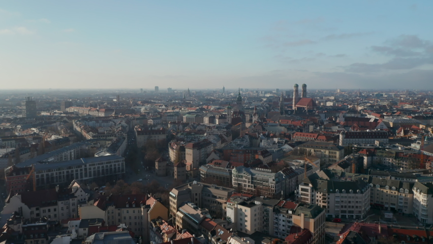 Beautiful City View over Munich, Germany with almost no traffic at Isa Tor, old city gate and Frauenkirche Cathedral in distance, Aerial View above Munich in Autumn