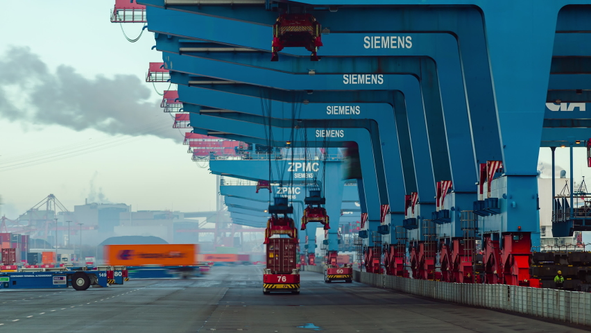 Container ship loading and unloading in deep sea port, Low angle View of business logistic import and export freight transportation by container ship, Automated transport vehicles Container loading cargo