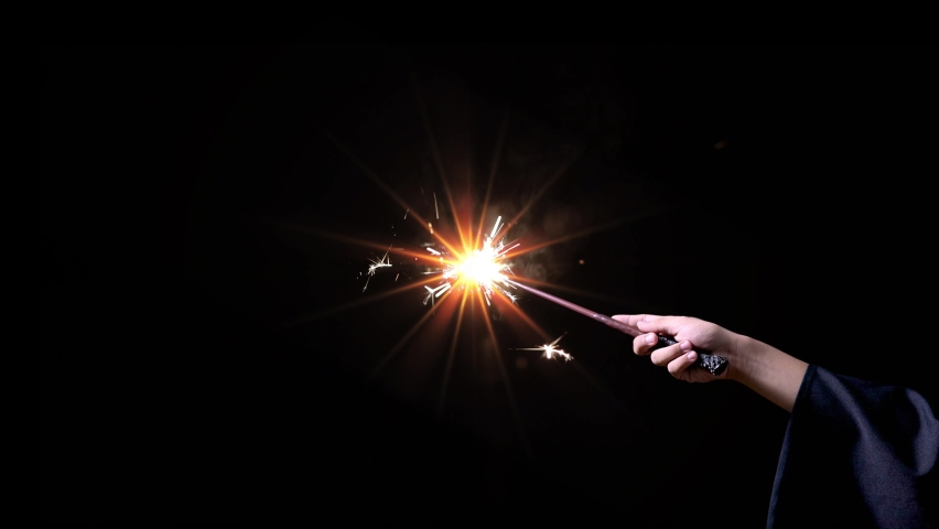 Magic wand with sparkle light up in the dark, Miracle magical stick with fire sparkle.