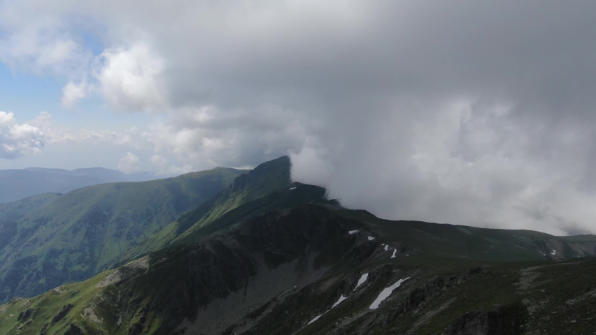 Towards the Clouds, shot by a drone. | Shutterstock HD Video #1063507402