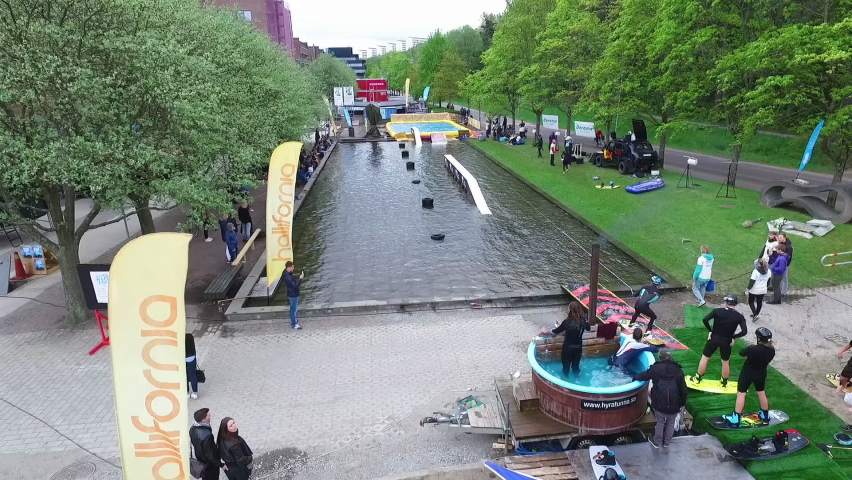Gothenburg , Sweden - 05 03 2016: Aerial Shot of a Wakeboarder doing Tricks and Jump at a Wakeboard Contest at Chalmers, Gothenburg, Sweden.