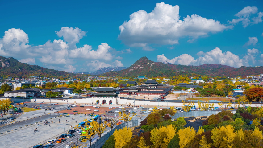 Time lapse 4k Aerial view of Gyeongbokgung Palace in autumn at Seoul South Korea And blue sky and white clouds(Gyeongbokgung palace is Korea National Treasure No. 1)