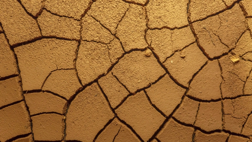 cracked soil in a desert drying out timelapse, drought concept. earth drying time lapse. water scarcity, lack of water, climate change and global warming. ecology concept, nature landscape. water use Royalty-Free Stock Footage #1063528861