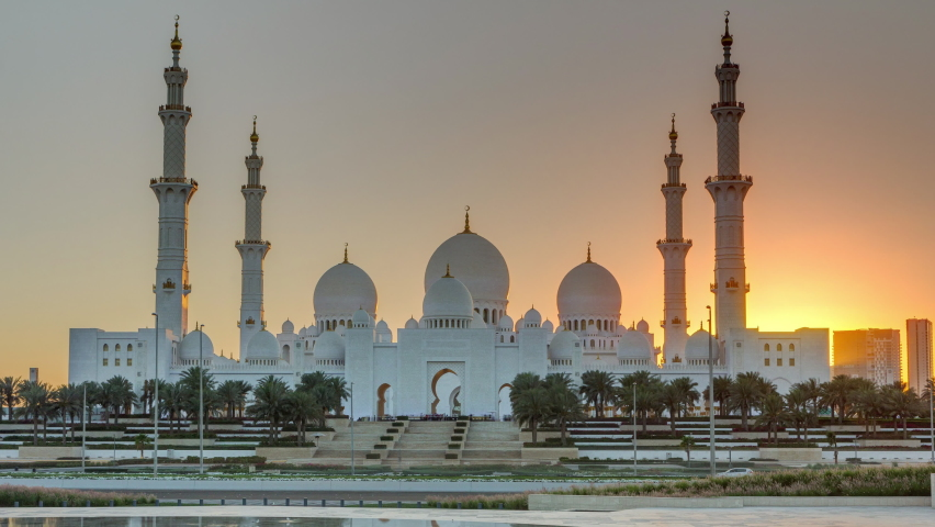 Sheikh Zayed Grand Mosque in Abu Dhabi at sunset timelapse, UAE. Evening view from Wahat Al Karama | Shutterstock HD Video #1063533355
