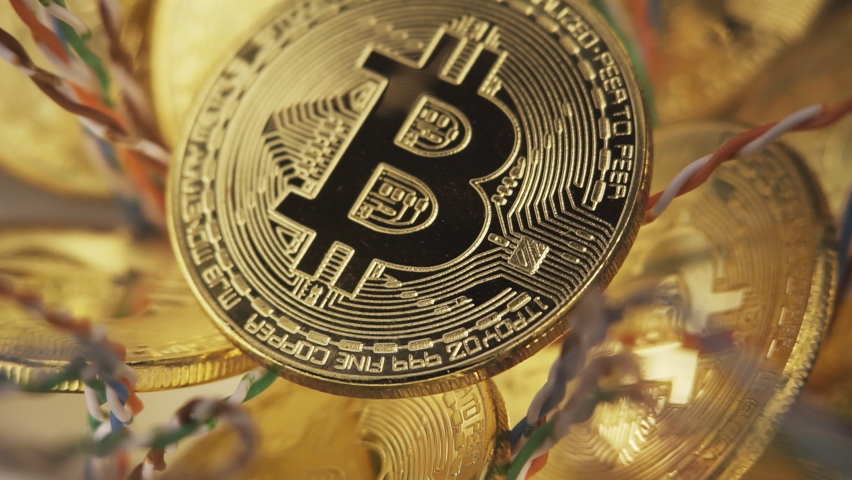 Crypto currency, bitcoin. BTC, Bit Coin. Blockchain technology, bitcoin mining. Macro shot of rotating bitcoins Royalty-Free Stock Footage #1063539454