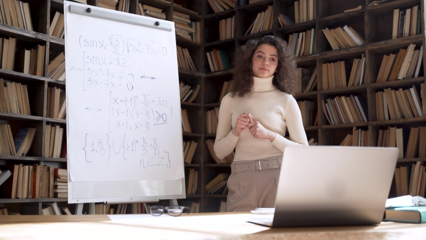 Hispanic young woman university teacher giving online math class explaining equation during school webinar video call lesson elearning conference call laptop computer. Virtual remote teaching concept. Royalty-Free Stock Footage #1063547104