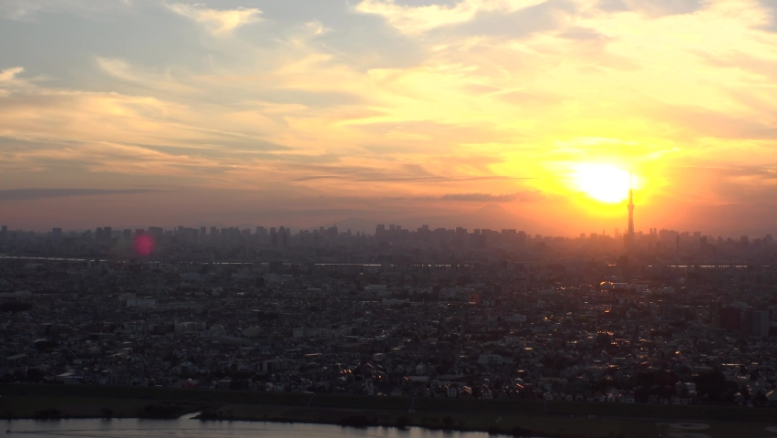 TOKYO, JAPAN : Aerial high angle sunrise CITYSCAPE of TOKYO and MOUNT FUJI. View of rising sun and buildings at downtown area. Japanese city life and nature concept. Time lapse shot night to morning. | Shutterstock HD Video #1063551508