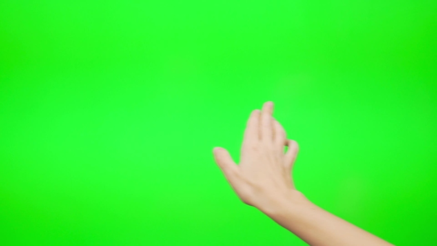A Girl Flips Slides Touches Her Hand on a Large Green Touch Screen, Green Background, Touch Digital Device, Touch Computer, Laptop. Close-up of a Woman's Hands and a Green Touch Screen.