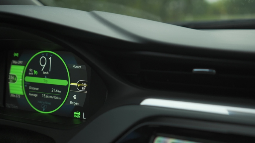 Electric car vehicle dashboard view during driving at 90 kilometers per hour speed. Power consumption. Battery recuperation and regeneration sign. Future of car industry | Shutterstock HD Video #1063567594