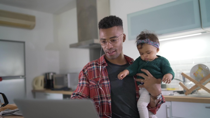 Daddy with babygirl teleworking from home during lockdown