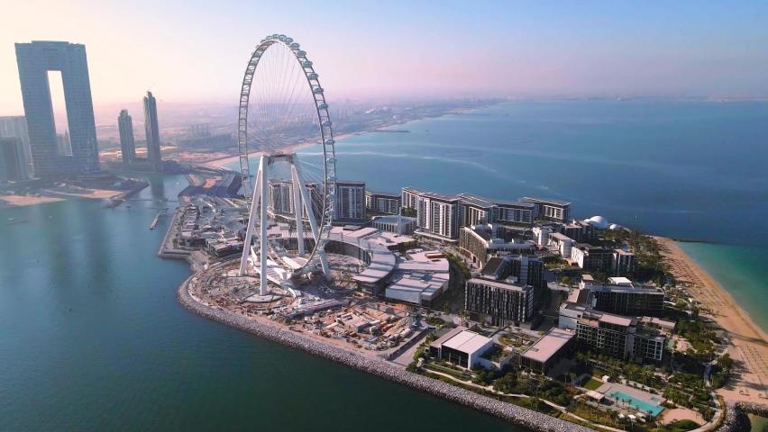 Dubai, United Arab Emirates - December 5, 2020: Bluewaters island and Ain Dubai ferris wheel on in Dubai, United Arab Emirates aerial footage. New leisure and residential area in Dubai marina area