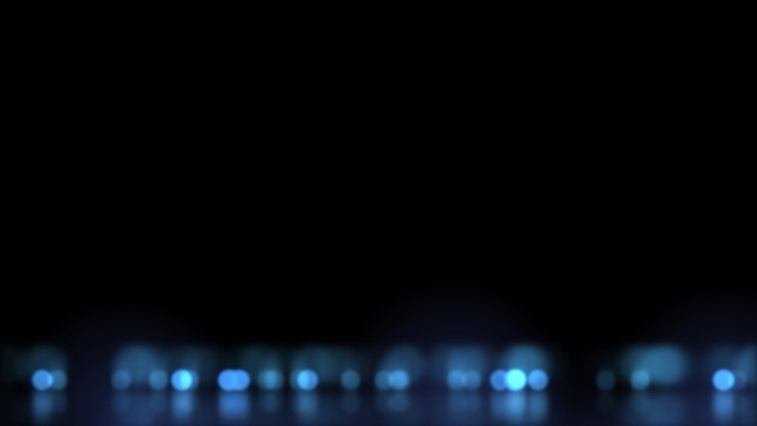 Abstract motion background with blue bokeh lights reflecting on floor.