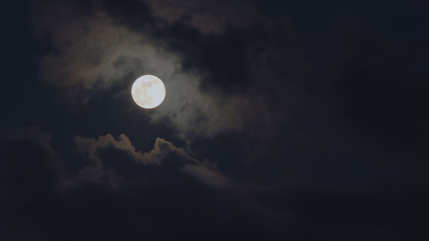 Clouds passing by moon at night. Full moon at night with cloud real time. mystery fairyland scene.  | Shutterstock HD Video #1063588240