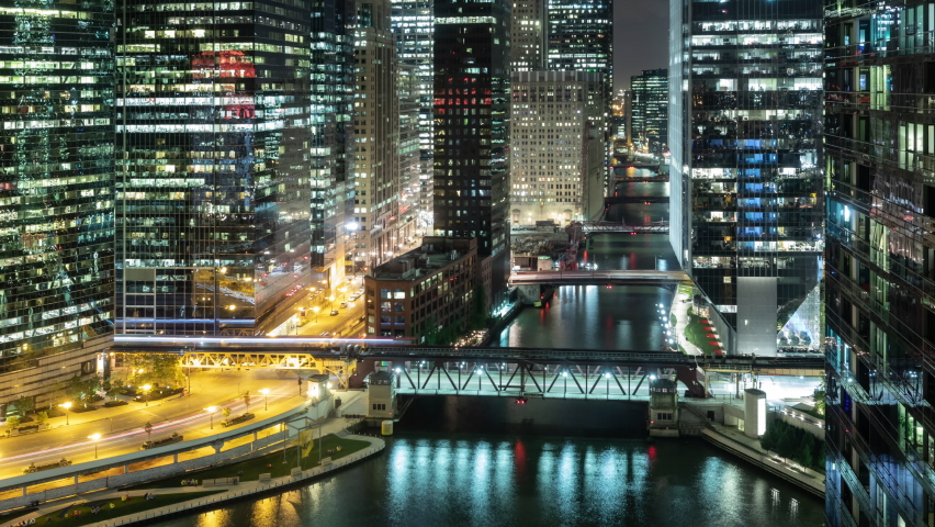 Beautiful time lapse of the many high-rise buildings along the Chicago River at night. | Shutterstock HD Video #1063600144