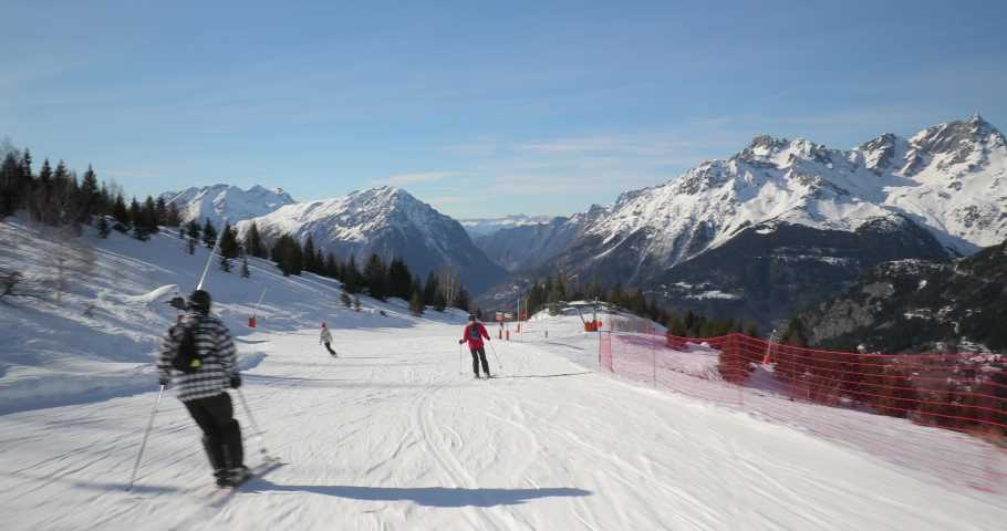 Skiing in the alps, first person point of view sliding down the snowy slope | Shutterstock HD Video #1063607545