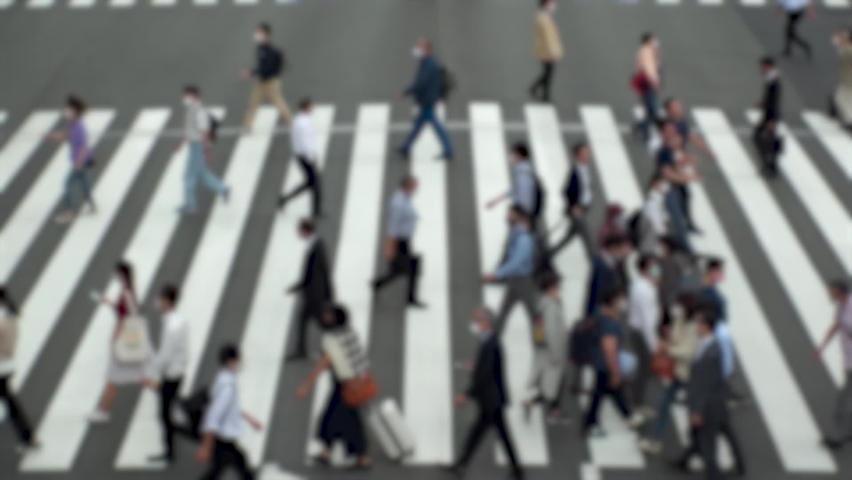 TOKYO, JAPAN : Aerial high angle view of crowd of people walking at zebra crossing in rush hour. Commuters at the street. Japanese city lifestyle, business and work concept. Slow motion blurred shot. | Shutterstock HD Video #1063618378